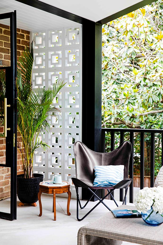 On the terrace, a 'Butterfly' chair from Kmart and stool from India stand out against the Besser blocks.