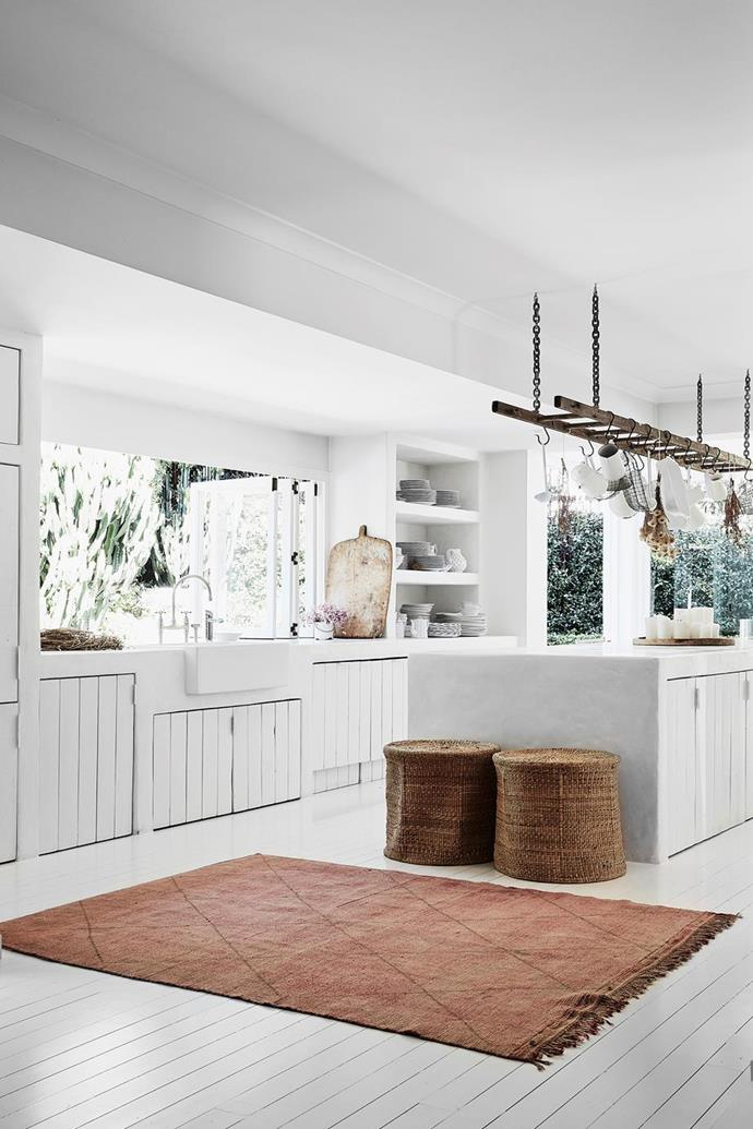 "[Romi Weinberg's kitchen](https://www.homestolove.com.au/modern-rustic-interior-design-21024|target=""_blank"") uses accent raw details like a ladder for utensil [storage](https://www.homestolove.com.au/kitchen-storage-tips-7930