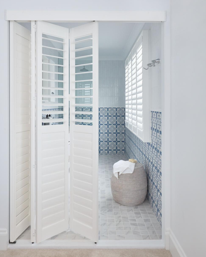 """The shutters are moisture-resistant, so we were able to put them in the ensuite too,"" she says. Garden Island mosaic floor tiles and Marley Beach wall tiles, Tile Cloud."