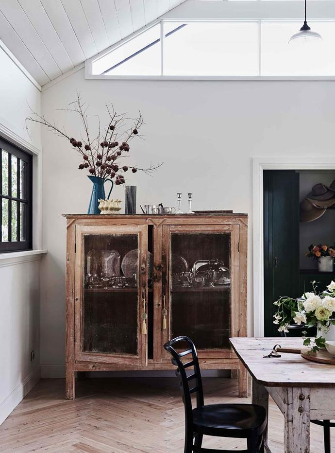 "Repurposed tables and cabinets are a simple way of creating the modern rustic aesthetic. In an [expanded cottage on a Rose Farm near Yass](https://www.homestolove.com.au/rose-farm-cottage-20409|target=""_blank"") a former meat safe in the dining room is now a sideboard beside a [dining table](https://www.homestolove.com.au/round-dining-room-table-design-ideas-19998