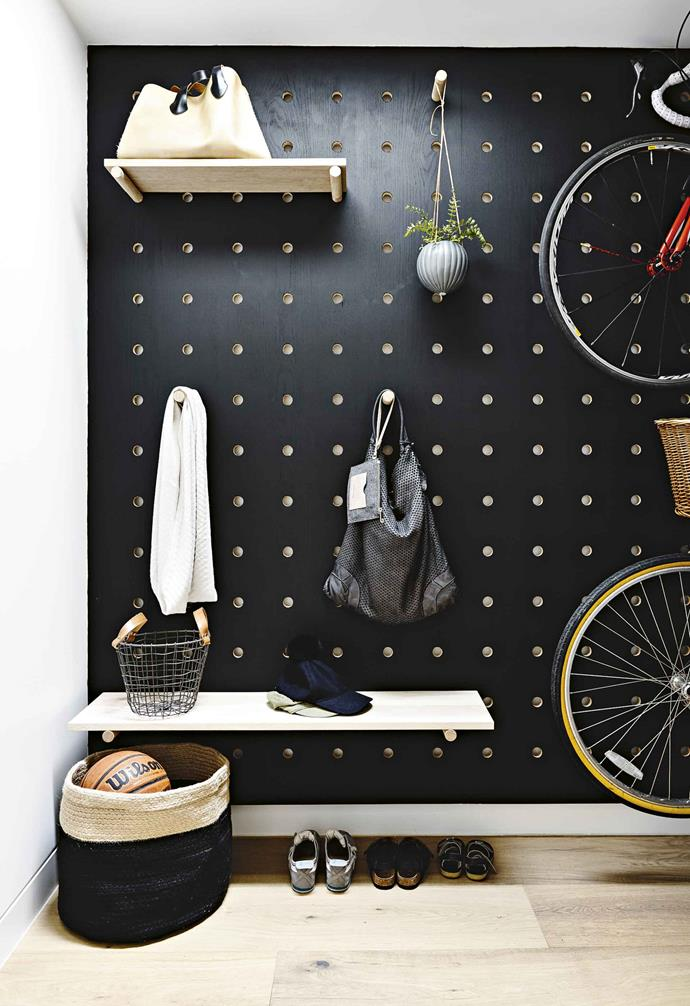 **CUSTOM WALL**<br><br>We love the clever design of this mudroom space where the main wall features a statement ceiling-to-floor pegboard. The customisable design means that the owners can easily configure the wall to suit their storage needs whenever they like.