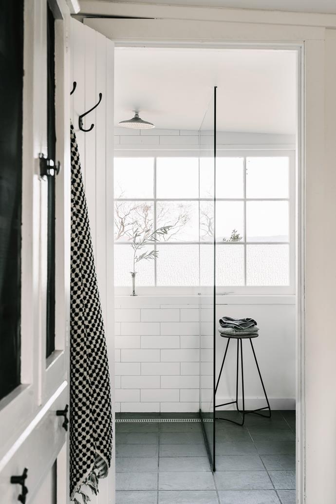 In the bathroom is a stool is from Joyce Antiques and the towel on the door is from The Evandale Village Store. The tiles are from Montile.