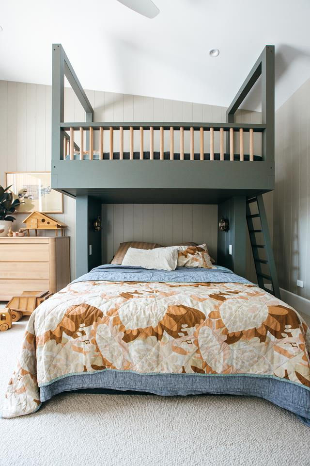 "Kyal and Kara have built their dream [family home](https://www.homestolove.com.au/kyal-and-kara-rumpus-and-kids-room-21382|target=""_blank"") on the NSW Central Coast. Natural tones make the kids' room feel calm and cosy while colour is introduced through the decor. The bunk bed was painted in Taubmans Endure 'Charcoal Grey'."