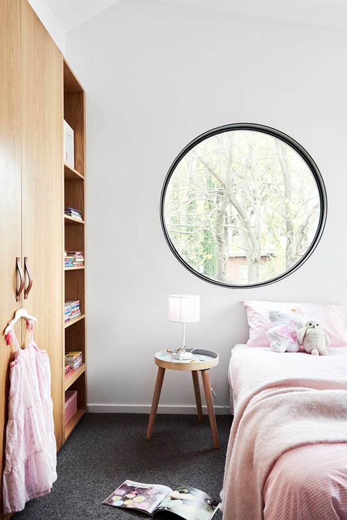 "A [Japanese-inspired home](https://www.homestolove.com.au/melbourne-japanese-industrial-home-6051|target=""_blank"") in Melbourne has continued it's zen attitude into a girl's room that features a unique portal window into nature. The soft pink and light timber palette is calming and inspiring."