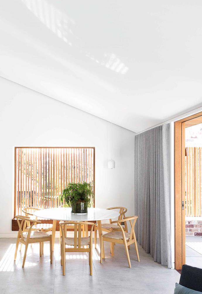 "**Dining** This area leads out to the front terrace. The striking marble table is from [Harpers Project](https://www.harpersproject.com/|target=""_blank""