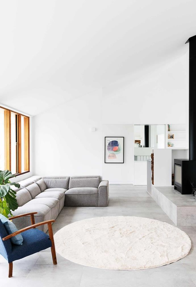 "**Living area** There's space to spare in here, and what looks like a wood-burning stove is actually a gas heater. ""It brings a Scandinavian element to the room,"" says Katie. J Elliot 'Emilia' round faux-fur rug, [Temple & Webster](https://www.templeandwebster.com.au/