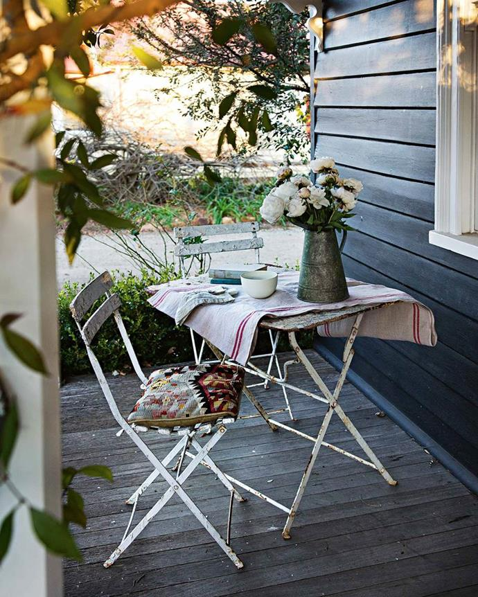 "Sometimes, all it takes it two to make a party, and this sweet outdoor area is sitting pretty on the verandah of this [weatherboard cottage in Bowral](https://www.homestolove.com.au/weatherboard-cottage-in-bowral-13647|target=""_blank""), just waiting for it to happen."