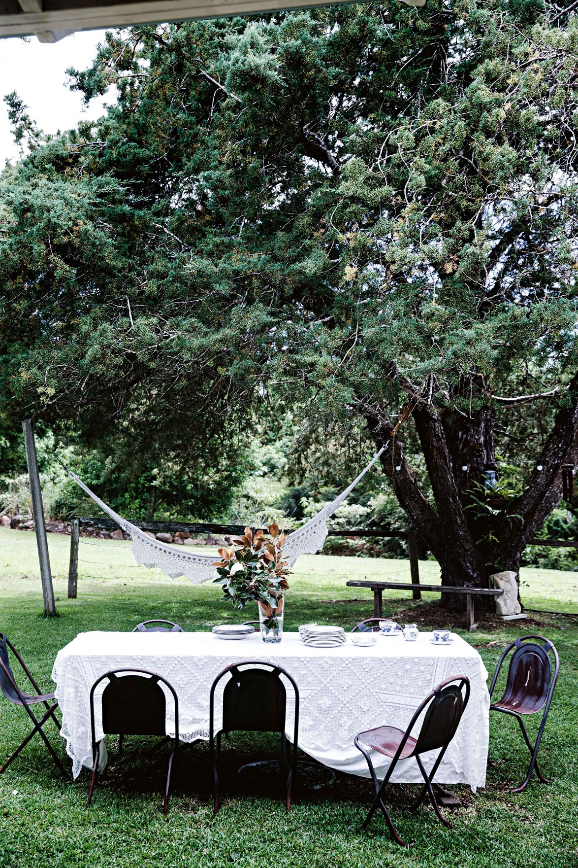 Entertaining outdoors? String up a hammock nearby so guests (or yourself) can sneak away for a post-lunch nap.