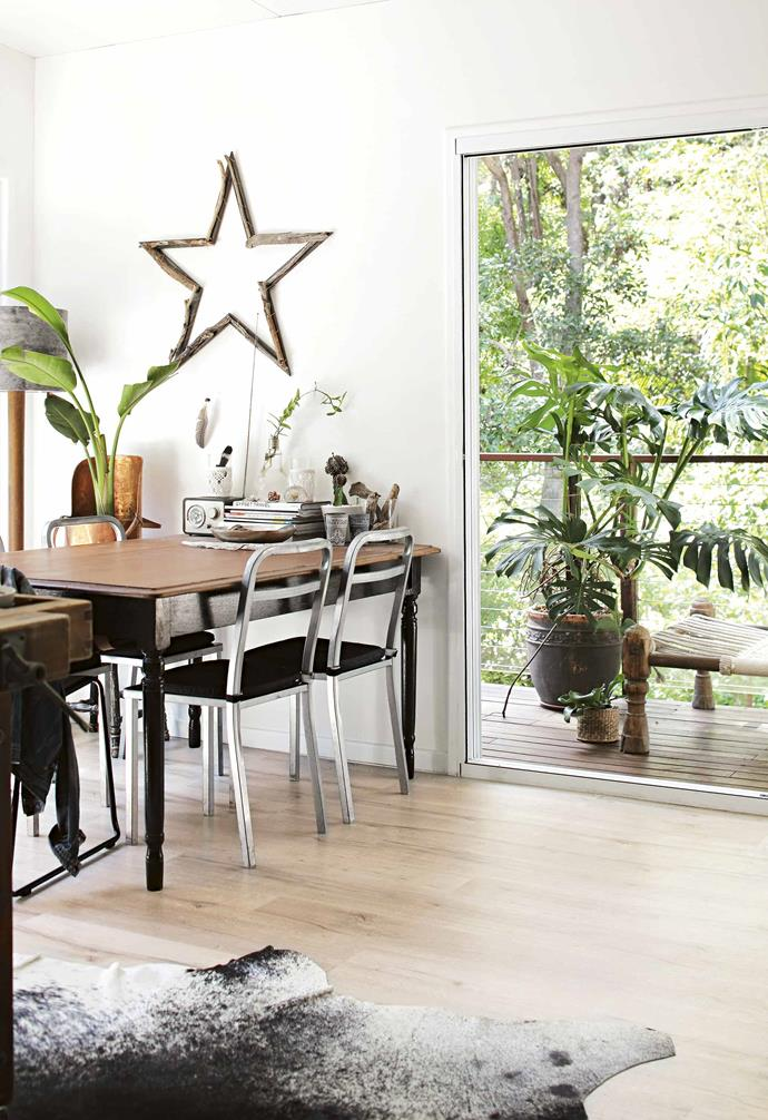 "**Repurpose and renew** Lara's kitchen is bathed in light that streams in through the floor-to-ceiling glass door. The star on the wall was a [DIY art project](https://www.homestolove.com.au/diy-home-projects-12978|target=""_blank""). ""I created it with one of my friends. The idea was to make it out of driftwood but all those angles made it impossible. We ended up constructing a timber frame and fixing the driftwood on top."" The [dining table](https://www.homestolove.com.au/buyers-guide-to-dining-room-tables-8365