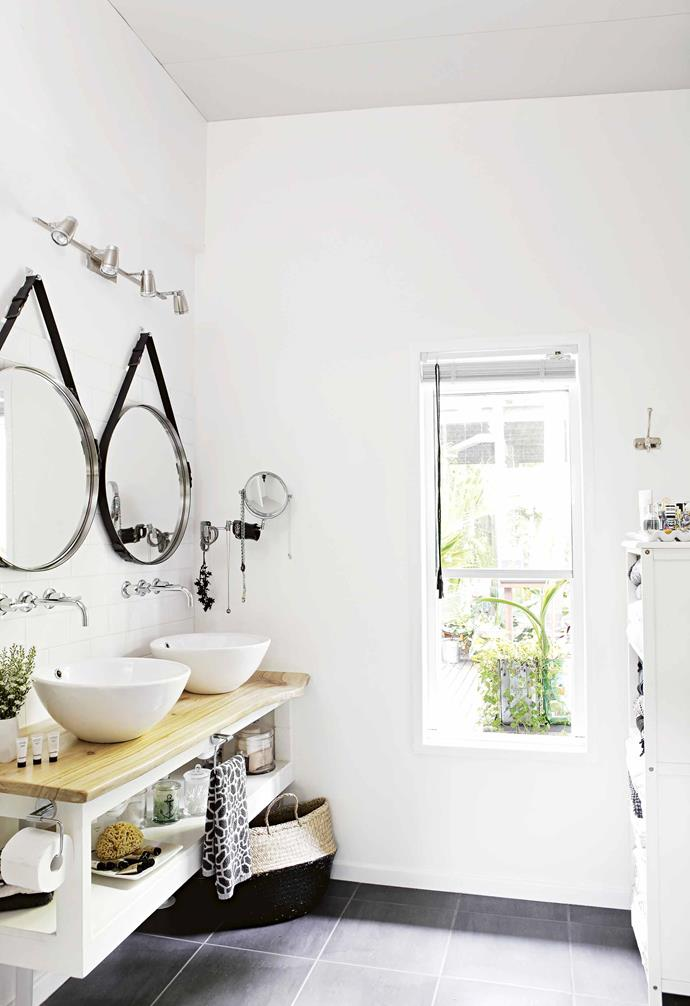 "**On reflection** The his-and-hers mirrors are a key feature of the [bathroom](https://www.homestolove.com.au/modern-bathroom-ideas-21119|target=""_blank""). Lara had seen the look she was after,  so bought the round mirrors from [IKEA](https://www.ikea.com/au/en/
