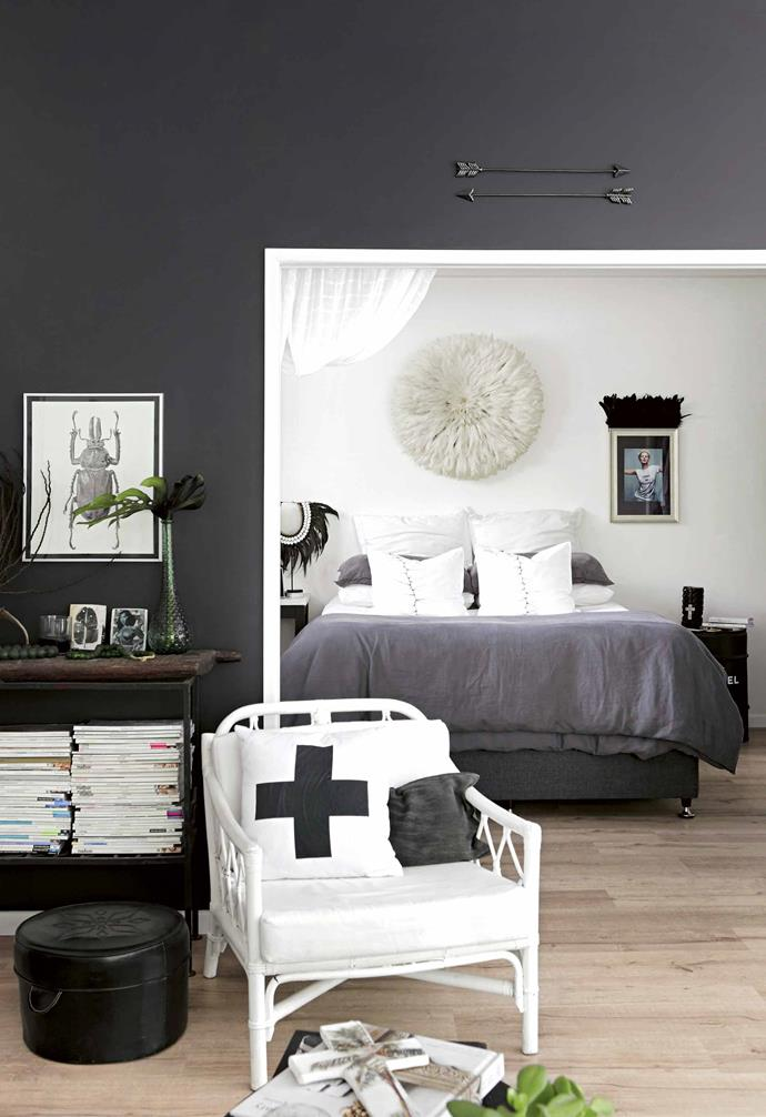 "**Divide and conquer** The [open-plan bedroom](https://www.homestolove.com.au/modern-bedroom-ideas-18706|target=""_blank"") takes advantage of the light that pours in through the living area. Recessed doors allow it to be closed off when necessary but, for the most part, muslin drapes are sufficient. On the bed are two 'Thorn' cushions from Lara's mother Kate's handpainted fabric collection, and the wall-mounted Bamileke Juju hat was a gift. ""It's an instant eye-catcher and you are drawn to the texture and softness,"" says Lara.<br><br>**Tip**: Think outside the square when it comes to bedheads – try a Juju hat or an artwork."