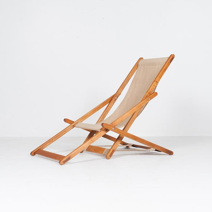 """Sun Lounge in Timber and Canvas, 1960s, The Netherlands, $2290, [Modern Times](https://www.moderntimes.com.au/shop/furniture/sofas-armchairs/armchairs/sun-lounge-in-timber-and-canvas-1960s-the-netherlands/