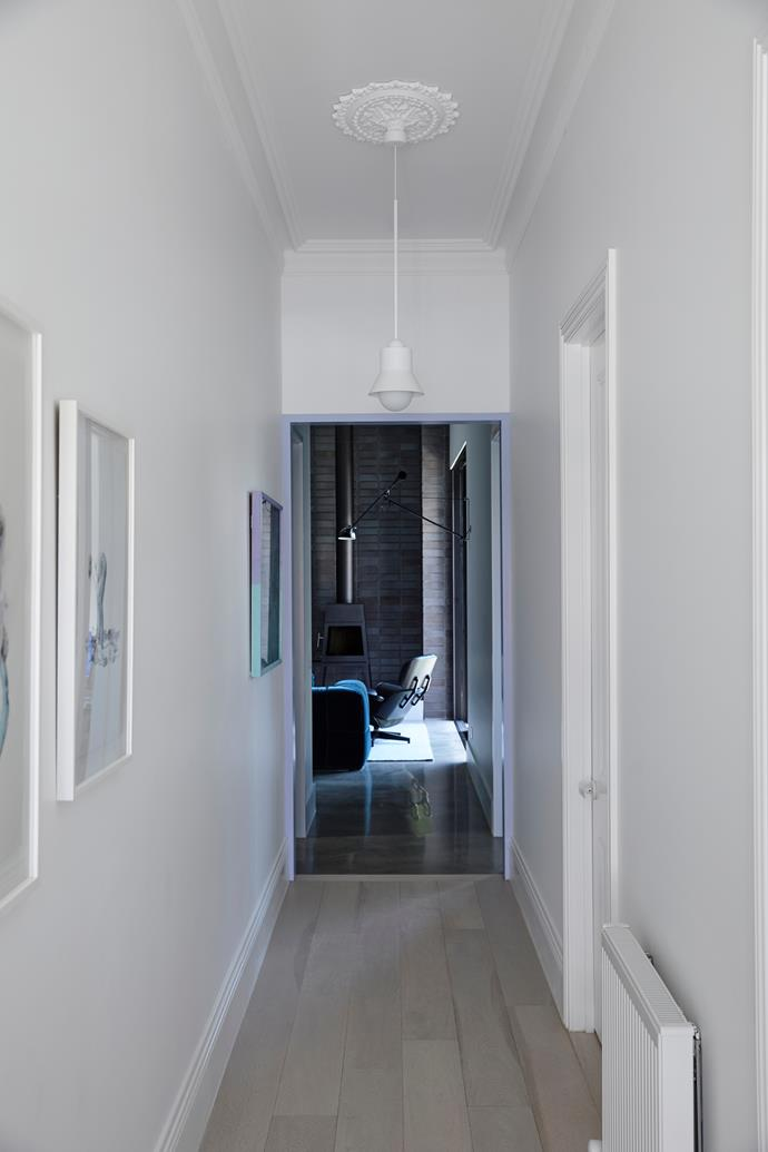 "The [hallway](https://www.homestolove.com.au/hallway-ideas-1811|target=""_blank"") in interior designer Lucy Bock's home features a lilac-painted archway that connects the original [Victorian front](https://www.homestolove.com.au/victorian-facades-20693