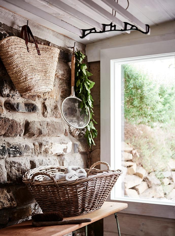 A standout feature of the laundry is a wall made from local stone. The French market basket, vintage ironing board and clothes drying rack (above) were picked up at Maldon Antique & Collectables Fair or found on eBay. The wire basket, used for harvesting vegetables, is from Much Ado.