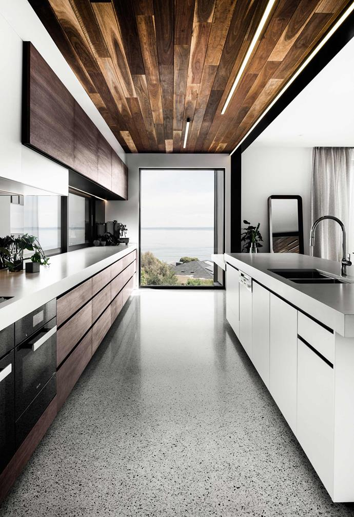 "Nestled on a sloping site, this [ultra-modern coastal home](https://www.homestolove.com.au/modern-coastal-house-19462|target=""_blank"") was designed to make the most of its breathtaking views. As such, black-framed windows and doors are a consistent design feature throughout, transforming the natural landscape into a living piece of art."