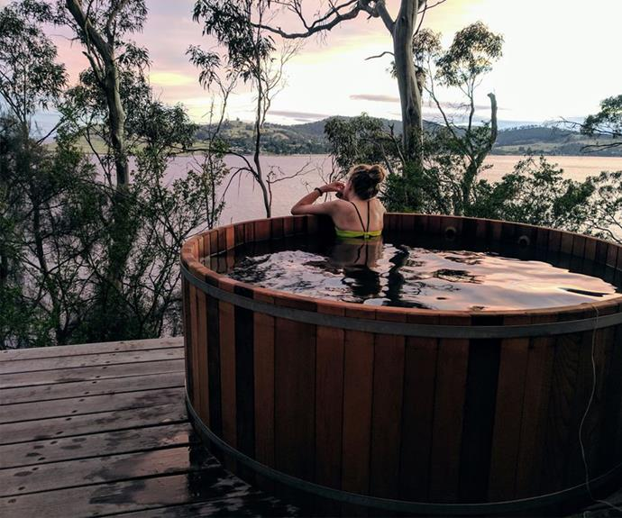 Soak in the Sea Water timber hot tub overlooking the ocean and Bruny Island.