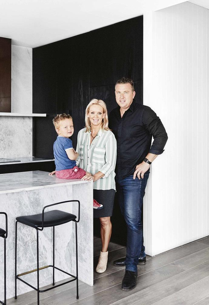 "Moving from a house into an apartment with three kids wasn't going to be an easy fit. But Ken and Beverley had done their research and knew that lifestyle would dictate the layout and feel of their home. For [family apartment living](https://www.homestolove.com.au/apartment-design-ideas-21538|target=""_blank"") to work, the design had to consider all the family members and offer functional zones so they could come together easily, and also retreat into private spaces.<br><br>**Portrait** ""We use induction cooking, which I believe is much better and safer than gas – and brings great peace-of-mind when our toddler is weaving in and out of the kitchen,"" says owner Ken, pictured with wife Beverley and son Robert."
