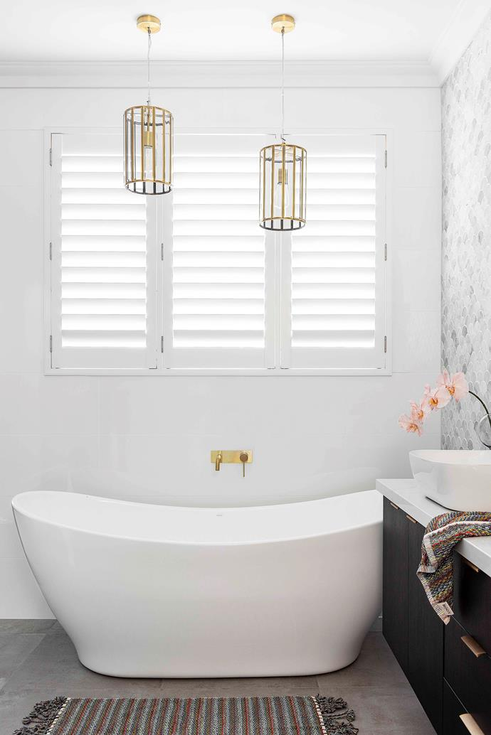 """There's nothing quite like taking a luxurious soak in the Caroma 'Cupid' freestanding bath, which perfectly fulfils Vesna's desire for """"a big, [beautiful bath](https://www.homestolove.com.au/freestanding-bath-design-ideas-4520 target=""""_blank"""") that you could just relax in"""". The duo of dazzling 'Pratt' [pendants](https://www.homestolove.com.au/14-pendant-lights-that-pack-a-punch-2989 target=""""_blank"""") from Roundabout Lighting helps deliver yet more wow-factor and adds another dash of gold. """"Our builder actually had to reinforce the ceiling to get those pendants in, they were so heavy,"""" reveals Vesna. """"But I'm so glad he did, because they look fabulous."""""""