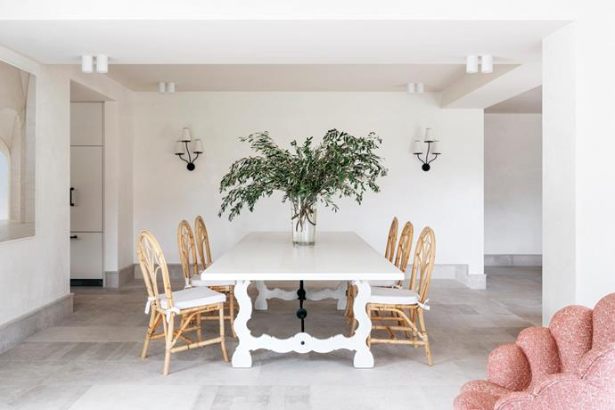 The owners bought the dining chairs in Singapore when the family was living there. The table is a custom design from Chatsworth Fine Furniture. Wall sconces by Aerin Lauder. The walls throughout have an otsumigaki plaster finish.