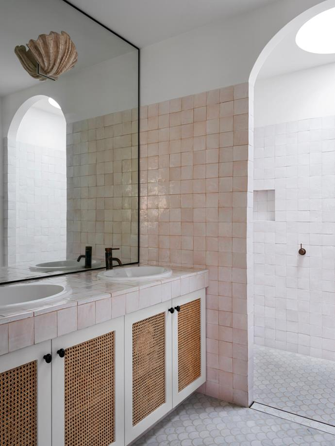 The brass mesh inserts are repeated in the ensuite bathroom vanity. Zellige wall tiles and Carrara marble 'Fish Scale' floor tiles from Bisanna. Shell light was found on eBay.