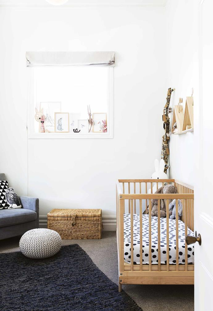 **Ivy's bedroom** Building from a monochromatic base, Ivy's room is warmed up with natural timber accents. The photo memory tree was crafted from a branch from a tree in the backyard, and sits alongside a Kalon 'Caravan' crib.
