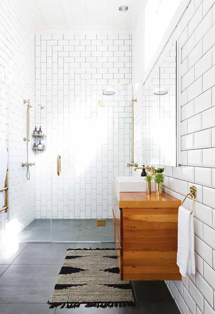 **Bathroom** The mix of horizontally and vertically laid subway tiles draw the eye across the room, while high windows offer plenty of light and privacy.