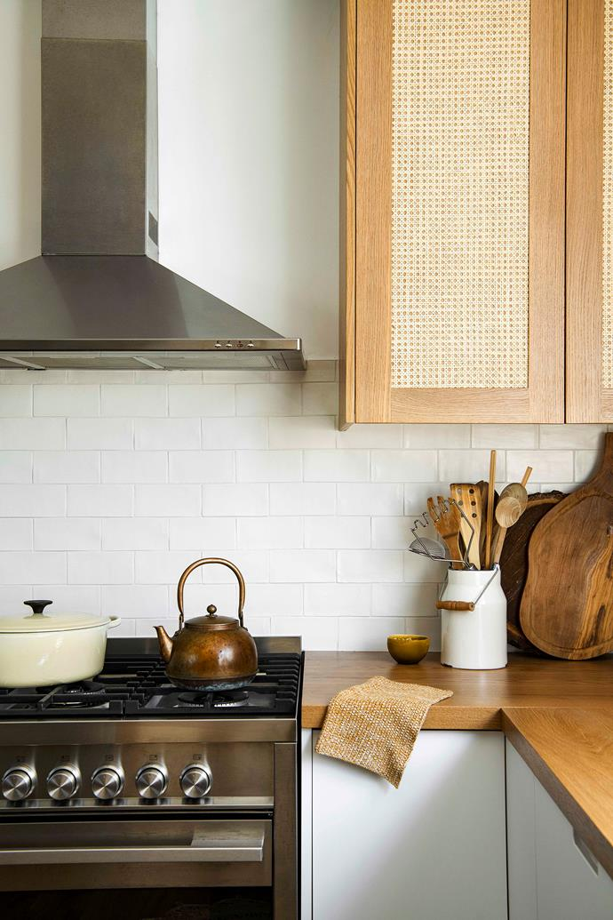 "American oak cabinetry with rattan inlay by Loughlin Furniture helps to visually connect the kitchen with the adjacent living room. ""I have [rattan](https://www.homestolove.com.au/rattan-furniture-trend-5592