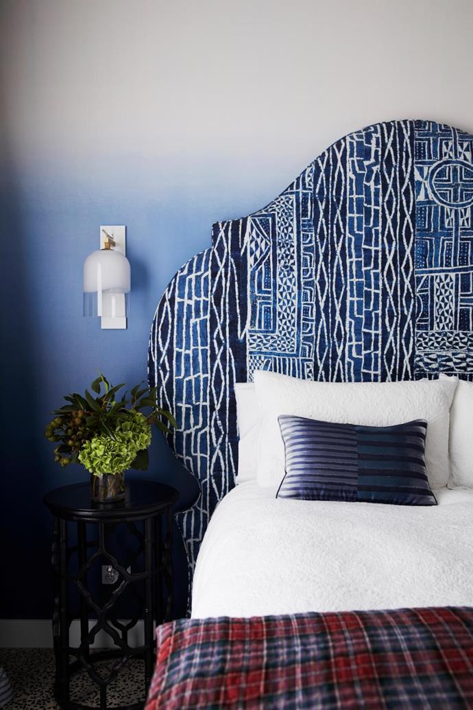 Ombré wallpaper, Designers Guild. Wall light, Articolo Lighting. Side table, Jean-Pierre Heurteau Design. Bedlinen, Adairs. Bedhead in Pierre Frey 'Namibie Indigo'.