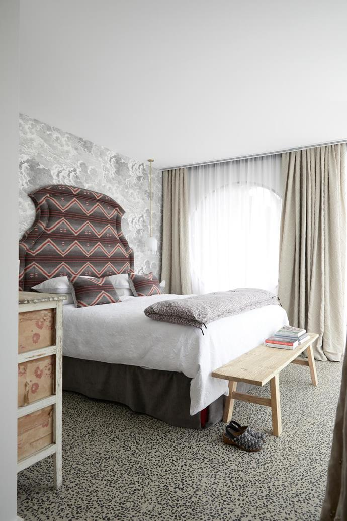 Fornasetti 'Nuvolette' wallpaper, Cole & Son. Bedhead upholstered in Ralph Lauren 'Sacred Mountain Blanket' fabric. Drawers, Manon Bis. Bench, Big Chair Living.