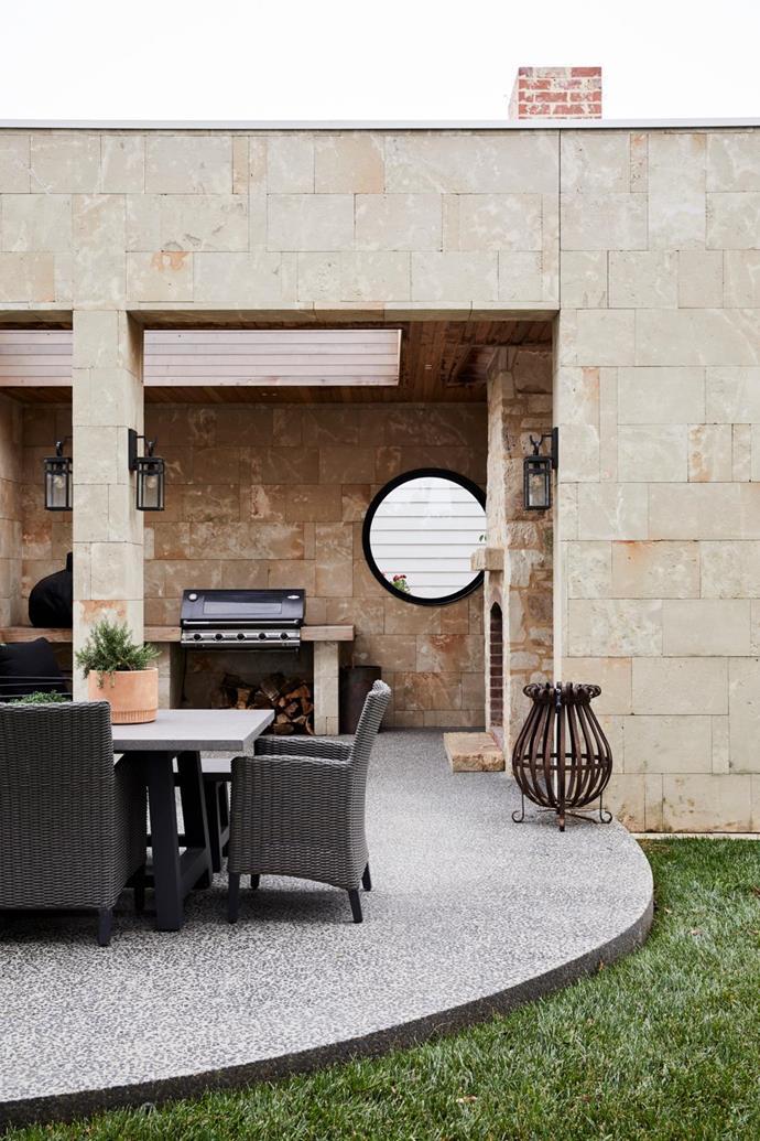 Limestone blockwork, Limestone Australia. Dining setting, Harvey Norman. BeefEater Morso Forno barbecue, Wignells Heating & Cooking. Lights, Hinkley.