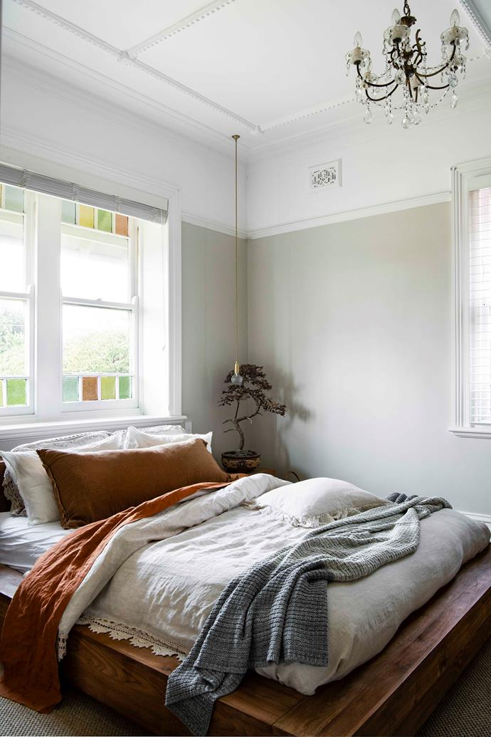 """Layers of luxurious [bedlinen](https://www.homestolove.com.au/how-to-pick-the-best-bedlinen-for-you-4649 target=""""_blank"""") (a collection from Cultiver, Kip & Co and Hale Mercantile Co), an antique chandelier and glittering Lee Broom 'Crystal Bulb' bedside pendants create the aura of old-world romance in the main bedroom. """"We don't have an adults' retreat away from the kids, so our bedroom needed to be that for us,"""" explains Mei."""