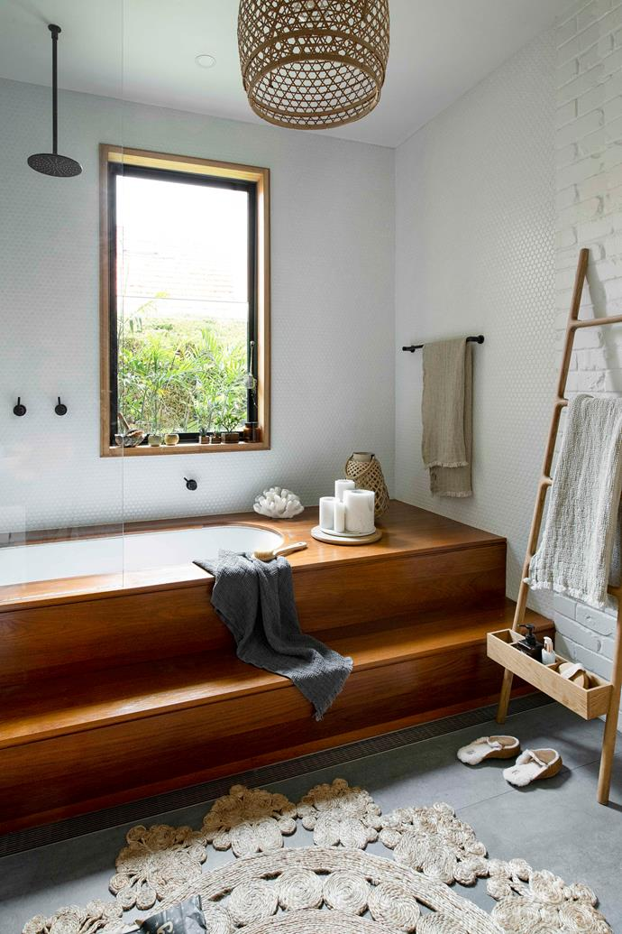 "A far cry from your typical wet zone, this bathroom enjoys the feel of a luxury eco resort, courtesy of its reliance on timber (marine teak to prevent water damage) and natural textures. ""We wanted to make it feel a bit like a spa, but it had to work with the rest of the house,"" says Mei. Eastcoast Joinery built the striking [bath](https://www.homestolove.com.au/freestanding-bath-design-ideas-4520