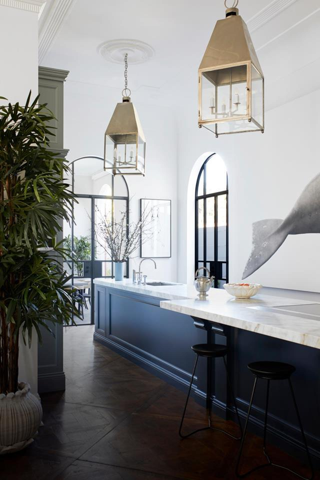 "This large kitchen within a [glamorous family home](https://www.homestolove.com.au/masonic-lodge-turned-glamorous-home-21425|target=""_blank"") boasts a bejewelled yet breezy scheme. A honed Calacatta Belgia marble island is the chef d'oeuvre of this multitasking space – Owner Dominique Hird notes that at just under 9m, it's one of the largest benches Euro Marble has ever made."