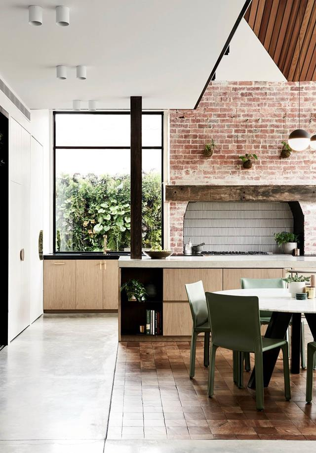 "Looking beyond the faded exterior, a family saw the potential to open up a bright new future for this [Edwardian-era beauty](https://www.homestolove.com.au/revived-edwardian-home-with-contemporary-extension-21325|target=""_blank""). ""We were happy to be able to retain some of the old house within the new extension, exposing the brick and keeping the original kitchen fireplace that now houses our oven,"" says the owner."