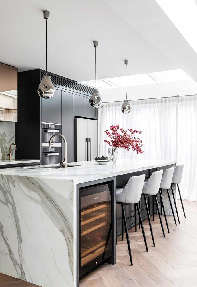 "**Kitchen** The Calacatta-marble island is the centrepiece. [Miele](https://www.miele.com/en/com/index.htm|target=""_blank""