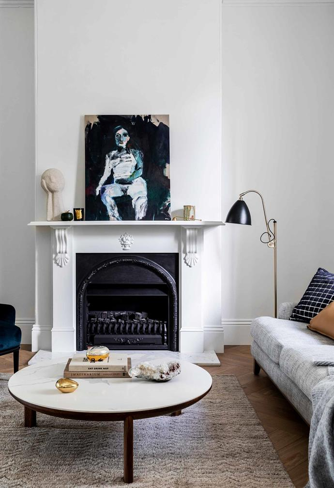 """**Fireplace** As in many Victorian homes, the fireplace in the front room is the focal point. Knick-knacks, a [Cire Trudon](https://www.trudon.com/