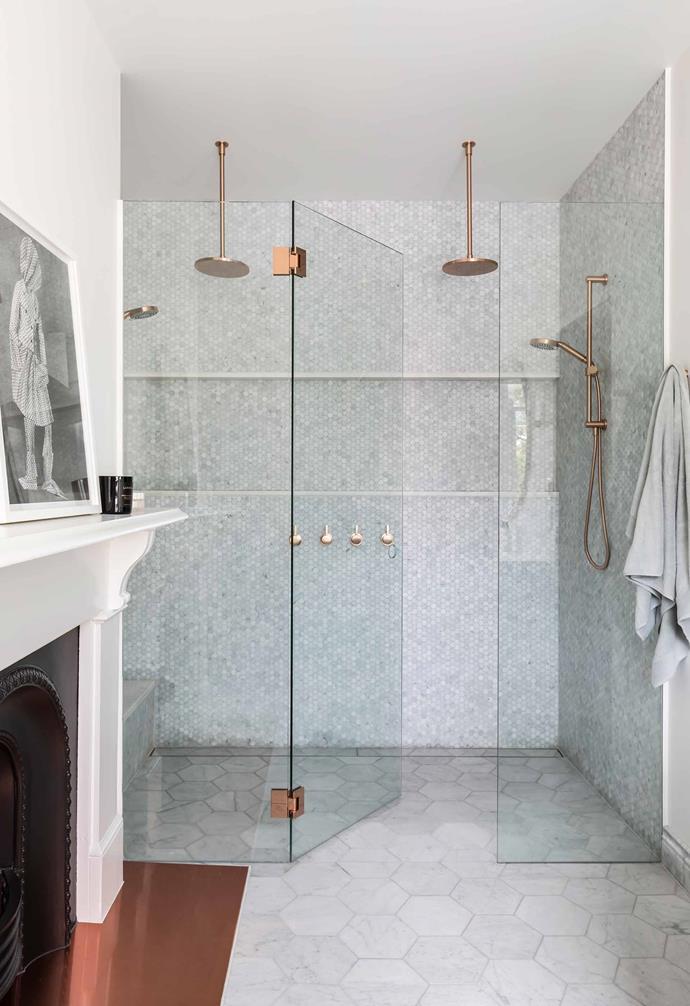 "**Bathroom** The fireplace's copper hearth contrasts beautifully with the Carrara Gioia Venato honed hexagon floor tiles by [Indigo Jones & Co](https://www.inigojones.com.au/|target=""_blank""|rel=""nofollow""). Shower rose, shower rail and ceiling dropper, all Brodware."