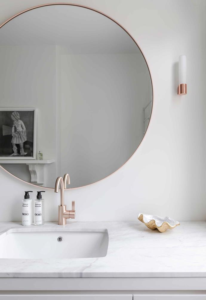 "**Bathroom** A generous slab of Calacatta marble forms the benchtop of the vanity in the bathroom. ""We ended up with more marble than we could have possibly imagined,"" the owners laugh, ""it was expensive, but worth it."""