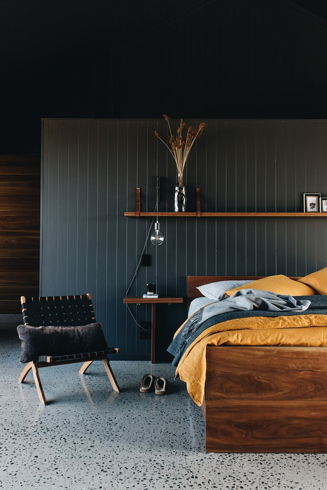 "A yellow bedspread offsets the moody hues (Dulux 'Monument') chosen for this bedroom in a [contemporary farmhouse](https://www.homestolove.com.au/contemporary-farmhouse-dark-interior-21657|target=""_blank"")."