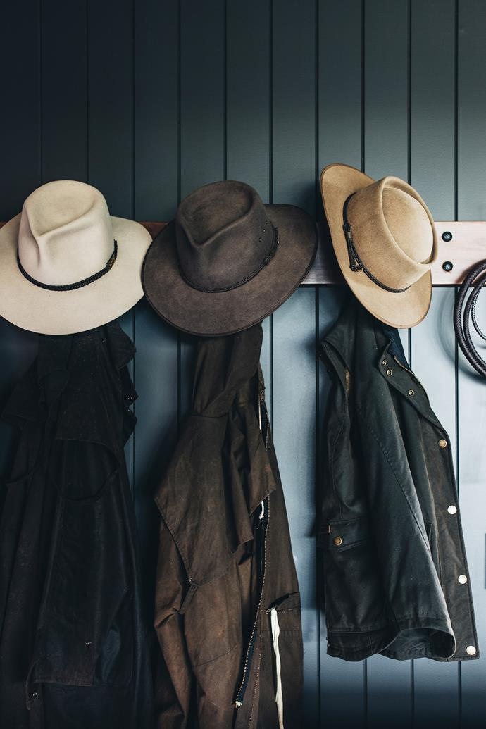 Hats and jackets near the home's entrance.