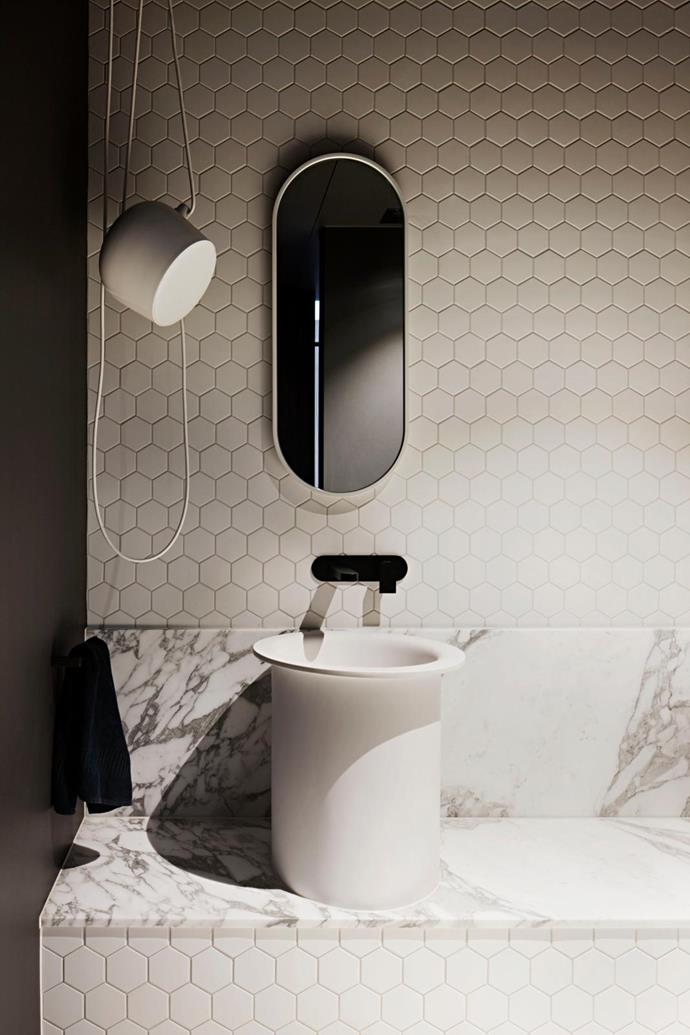 The Flos 'Aim' pendant light from Euroluce spotlights the Agape 'In Out' basin from Artedomus with Fantini taps from Rogerseller. Arabescato Vagli marble from Apex Stone. Hexagonal tiles from Perini. Gessi 'Goccia' mirror from Abey.