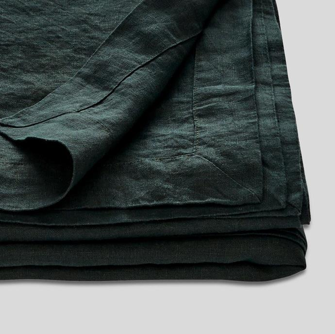 "100% Linen Table Cloth In Pine, $205, [In Bed](https://inbedstore.com/collections/table-cloths/products/100-linen-table-cloth-in-pine|target=""_blank""