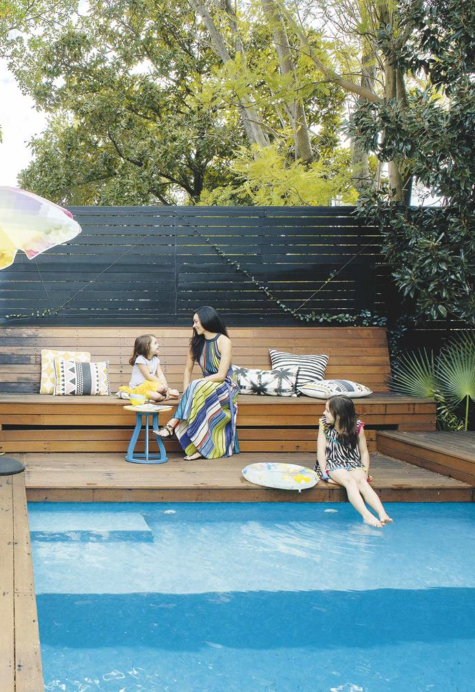 "Getting creative with your fencing can pay off. In the renovation of this [post-war brick bungalow](https://www.homestolove.com.au/post-war-brick-bungalow-perth-19521|target=""_blank"") the owners opted for dark slatted fencing for their backyard and pool area. The warm timber tones of the pool deck add a dramatic contrast, and the horizontal slats provide ample amount of privacy for the space."