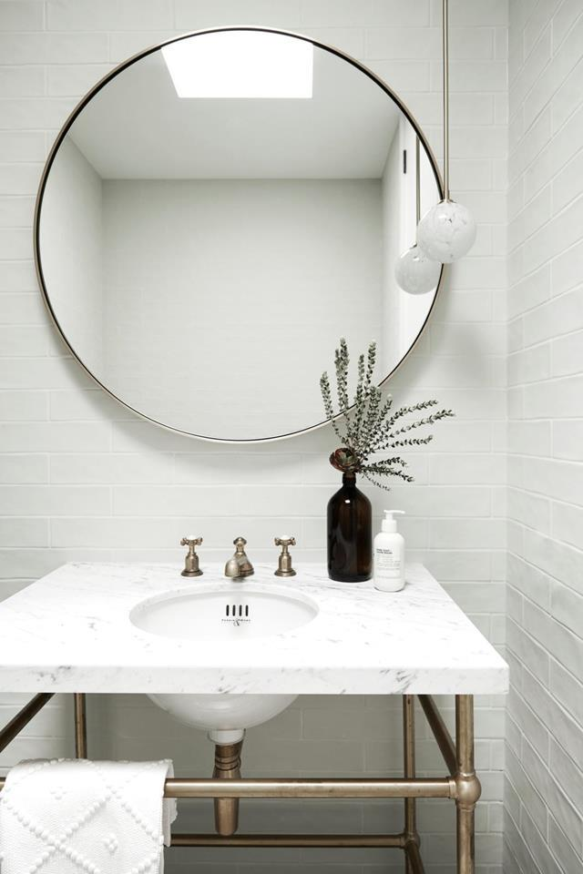 "One of the bathroom's within this beautifully [refurbished homestead](https://www.homestolove.com.au/beautifully-refurbished-homestead-mornington-peninsula-21651|target=""_blank"") features a predominantly white palette and free space under the vanity which helps to create the illusion of more room."