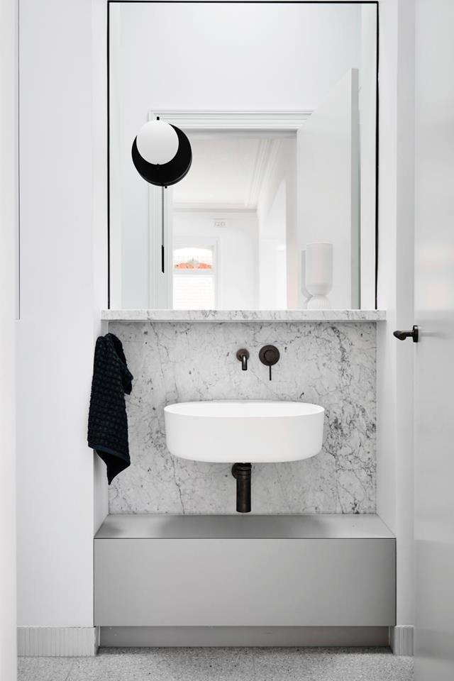 "This beautifully [monochrome bathroom](https://www.homestolove.com.au/timeless-black-and-white-bathroom-design-21496|target=""_blank"") was designed by  architect and interior designer Luke Fry. While the space may be small, the luxe finishes help to make it appear more luxurious."