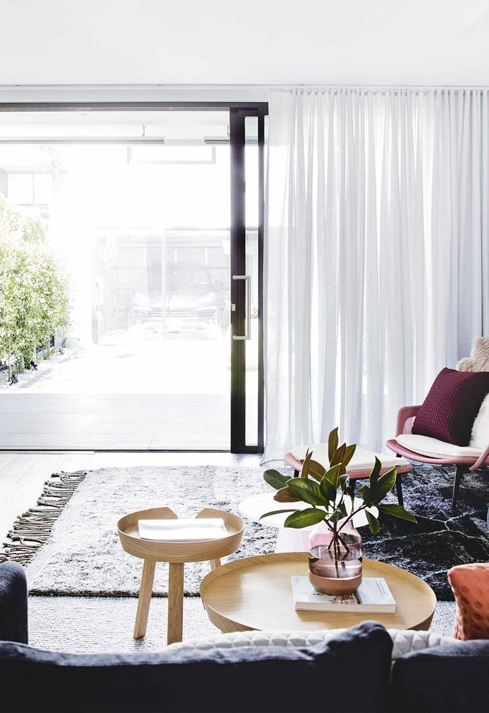 "**Rear living area** ""We spend 90 per cent of our day in this space so we made it as large as possible and then worked the rest of the ground-floor rooms around that,"" says Melanie of the updated layout. Muuto 'Around' coffee tables from [Living Edge](https://livingedge.com.au/