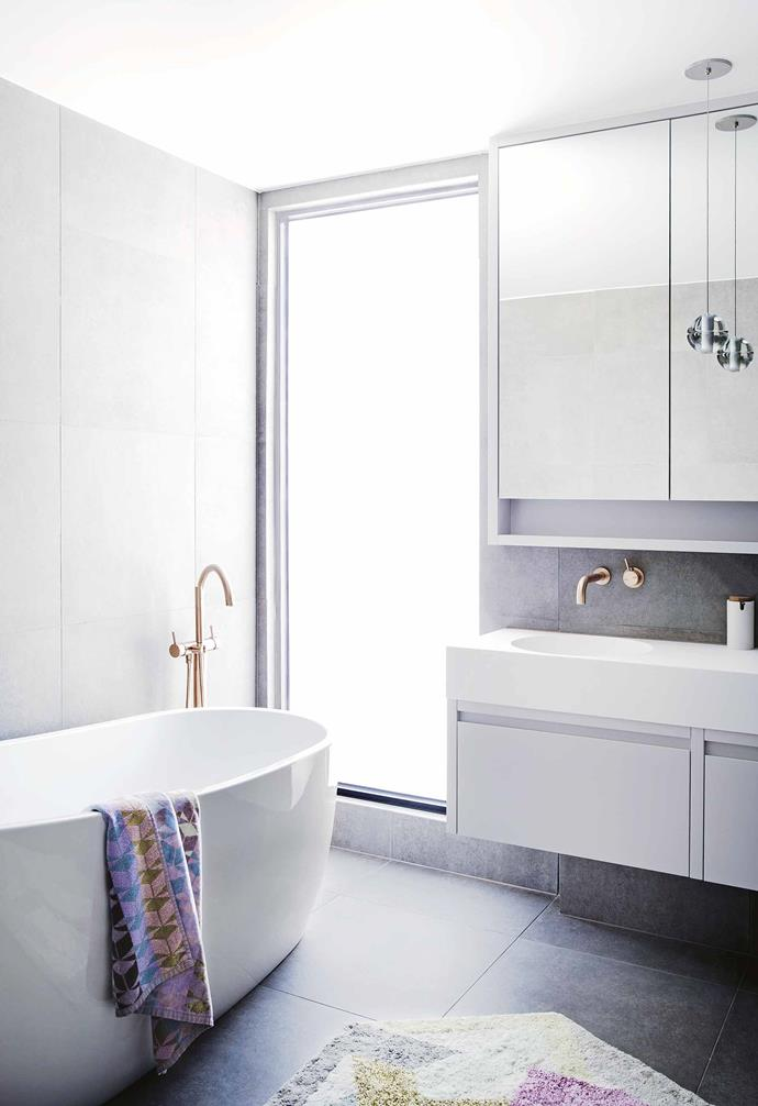 "**Kids' bathroom** A bath, closely followed by a double basin, was a must so that in the future Magnus and Eden could use the bathroom at the same time. The Kado 'Arc 1745' freestanding bath from [Reece](https://www.reece.com.au/|target=""_blank""