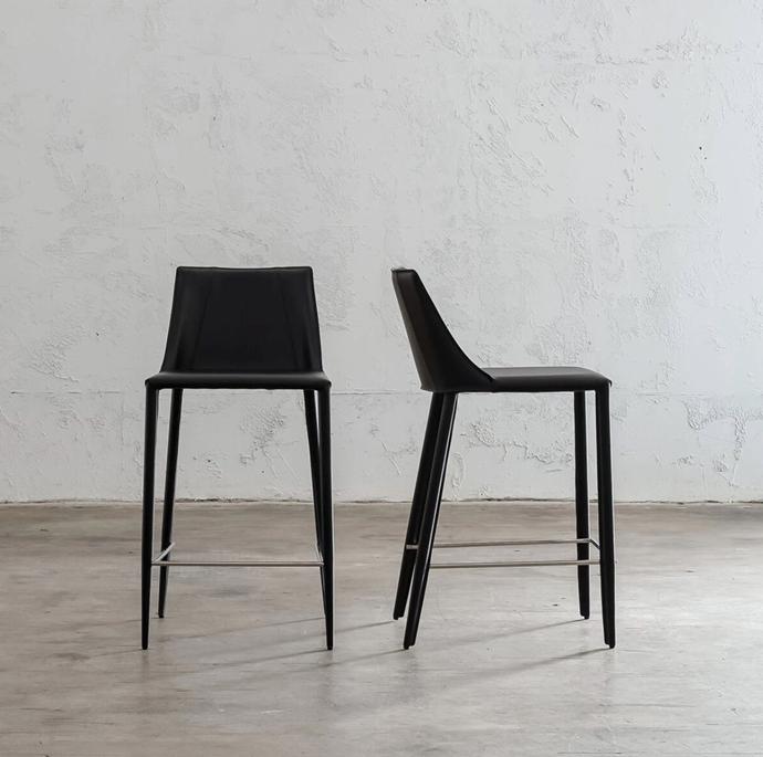"Ames Mid Century Vegan Leather Bar Chair in noir black, $329, [Living by Design](https://livingbydesign.net.au/collections/bar-stools-kitchen-stools-counter-stools/products/ames-mid-century-vegan-leather-bar-chair-noir-black|target=""_blank""|rel=""nofollow"")"