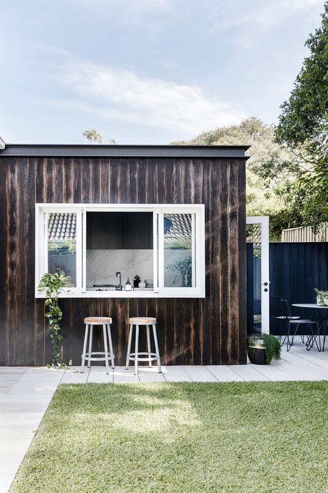 "A [servery window](https://www.homestolove.com.au/kitchen-servery-windows-21477|target=""_blank"") gets plenty of use in summer and provides the perfect conversation spot while someone is working in the kitchen in [interior designer, Kristy McGregor's home](https://www.homestolove.com.au/expert-renovation-and-interior-design-advice-5811