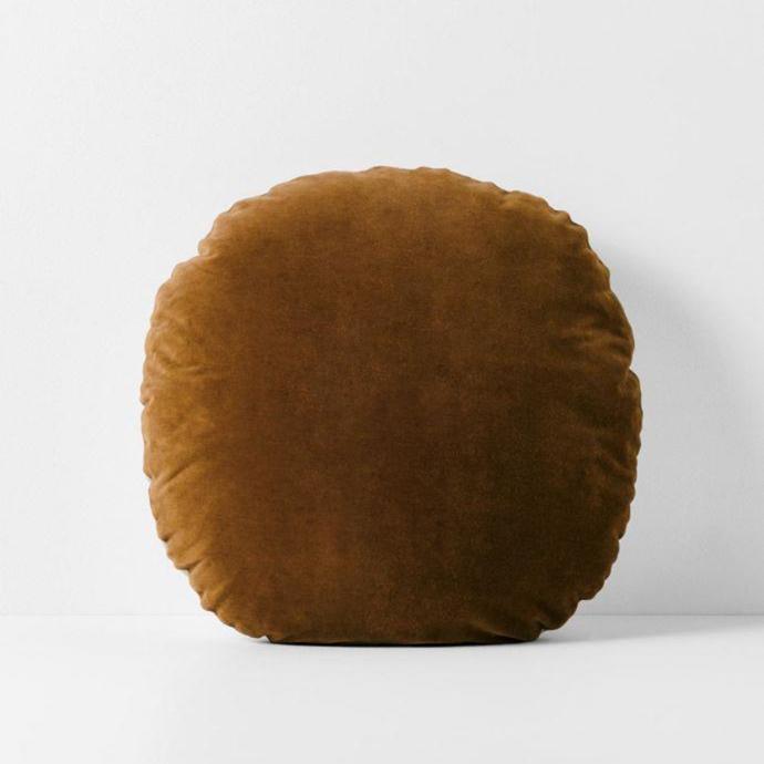"Luxury velvet round cushion, $79.95, [Aura Home](https://www.aurahome.com.au/luxury-velvet-55cm-round-cushion-tobacco target=""_blank"" rel=""nofollow"")"
